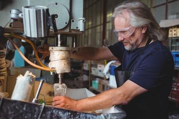 Glassblower working on a glass