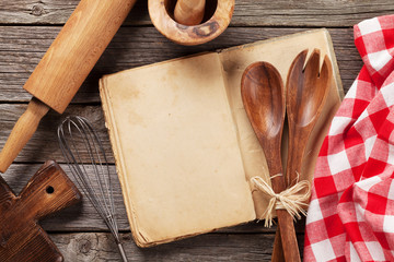 Blank vintage recipe cooking book and utensils