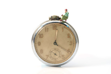 Toy worker / View of miniature toy worker on vintage clock.