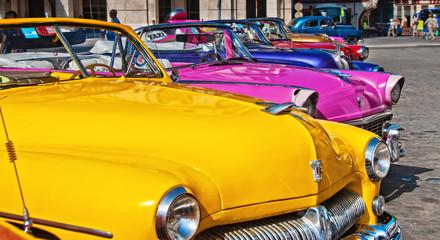 Colorful vintage classic American car in Old Havana street