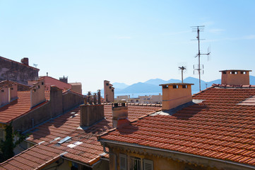 Tile brown roofs with mountain background