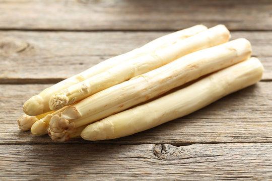 Fresh white asparagus on a grey wooden table
