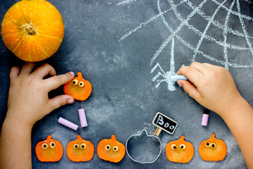 Preparing for Halloween - child draw with chalk cobweb and spider