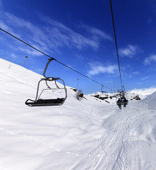 Chair-lift at ski resort in sun winter day