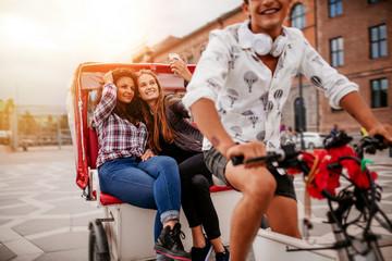 Female friends taking selfie on tricycle