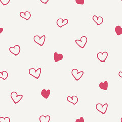 Seamless pattern with hand drawn hearts in pink on cream background.