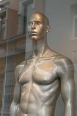 Male Torso in a shop window and reflecting streetview, männlicher Torso in einem Schaufenster und sich widerspiegelnde Straßenansicht