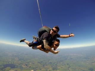 Skydiving tandem friends sunglasses