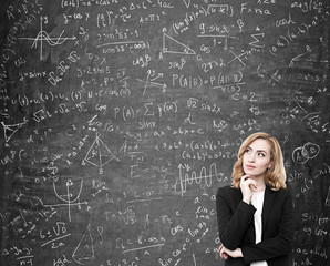 Woman with red hair solving a difficult problem