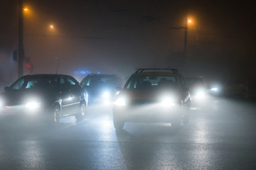 Cars driving in the fog at night