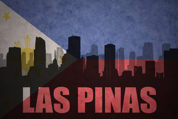 abstract silhouette of the city with text Las Pinas at the vintage philippines flag background