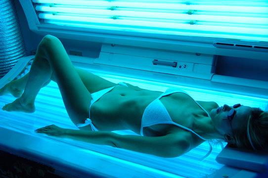 woman getting Solarium beauty treatment