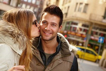 Closeup photo of kissing couple