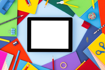 Back to school background with blank tablet screen and school supplies around. Back to school...
