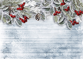 Christmas wooden background with snowy branch. View with copy space