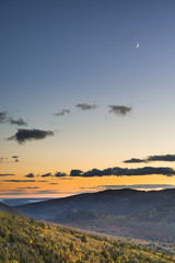Fototapete - Crescent Moon Over Mountains at Sunset in Fall