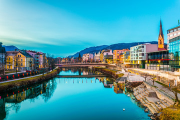 view of a riverside of river Drau during sunset in Villach, Austria Wall mural