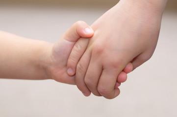 Children hands together holding - childhood friendship concept