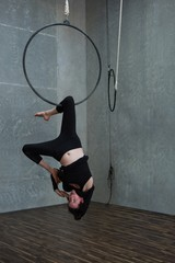 Gymnast performing gymnastics on hoop