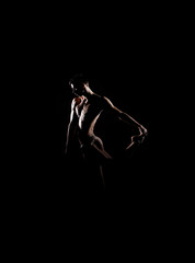 Silhouette trace of a male ballet dancer on black
