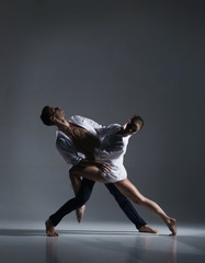 Couple of sporty ballet dancers in art performance.