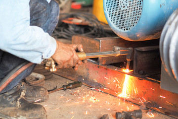 Sparks from the cutting,Repairing Motor Factory