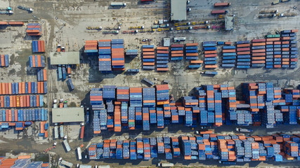 Aerial view of cargo containers piled together.