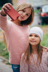 two beautiful little girls making selfie