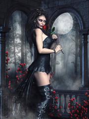 Dziewczyna wampir z czerwonymi różami stojąca na tle gotyckiego okna