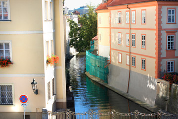 Prague, Czech Republic panorama with watercanal in town of Vltava.