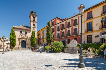 Sunny view of square and street of Granada, Andalusia province, Spain.