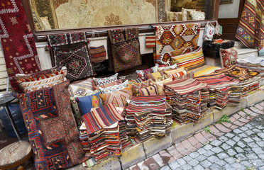 Traditional cushions and carpets in street of Istanbul,Turkey.