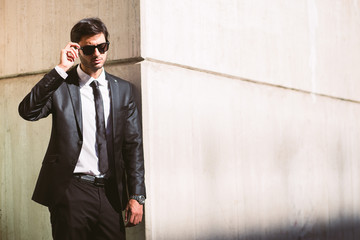 Elegant Young Businessman in the Street