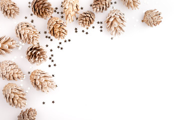 Christmas mockup desktop, pine cones and sequins on a white background, overlay your business message, design or quote. Great for small businesses, lifestyle bloggers and social media campaigns.