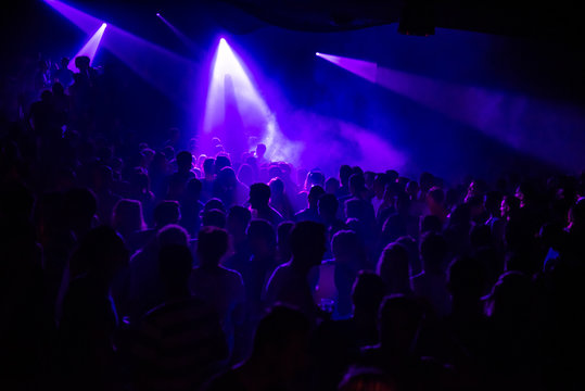 Purple lights in a crowded club