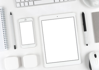 Responsive design: Keyboard, tablet and smartphone on white table