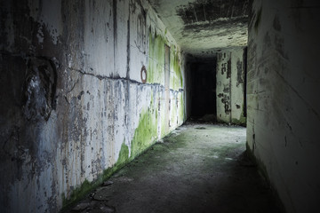 Empty abandoned bunker interior with black end