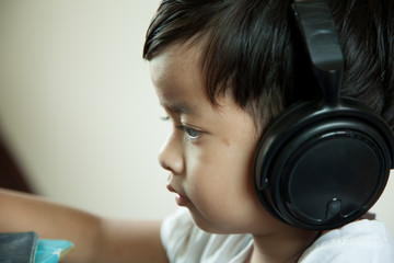 boy and gray background with headphones