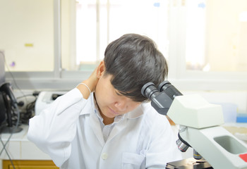 asia scientist working in biological laboratory.