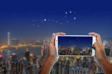 photography scorpion group of stars on city by phone