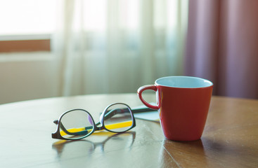 Work desk with glasses, Red coffee cup