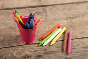 colored crayons on the wooden table