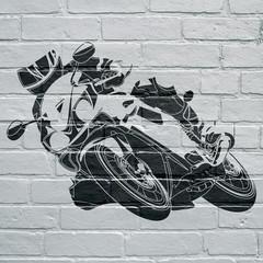Art urbain, moto prenant une courbe