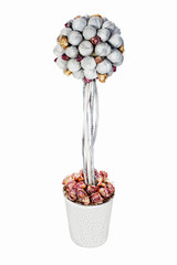Abstract composition from nuts and dry roses arrangement centerpiece in vase isolated on white background.