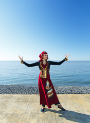 woman dancing georgian national clothes sea outdoors