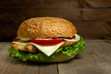 Home made hamburger on wooden background. Fastfood meal.