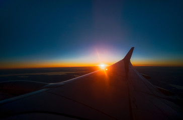 sunset from a plane travelling far