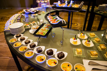 Close-up view of dessert buffet with delicious sweet bakery and