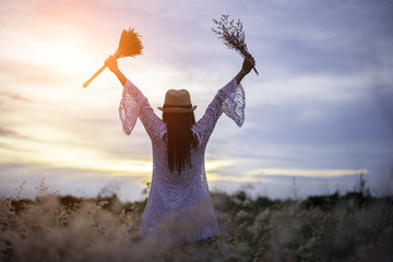 Woman in meadow. travel and sunset, soft and select focus