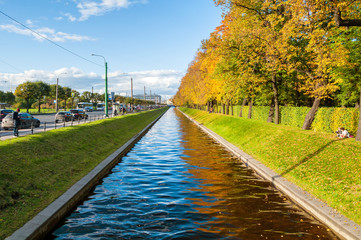 Autumn landscape of St Petersburg - Swan Canal and autumn park in sunny weather. St Petersburg autumn city landscape